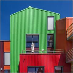 Orgères : Coloured Building (Hervé Marchand) Tags: blue red orange green lines architecture square rouge colours couleurs curves bretagne vert minimal bleu extérieur rennes ligne urbain courbes exterieur orgères