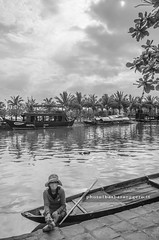 Along the river (Barbara Oggero) Tags: street streetphotography vietnam hoian boat river woman asia indochina landscape capture travel candid hat vietnamese water old city urban tropical tipical