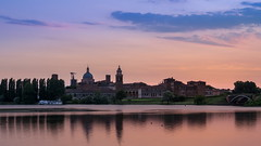 Mantova Skyline (Blueocean64) Tags: longexposure pink blue light sunset summer sky italy orange lake color reflection tree green nature water clouds photoshop landscape outside boat eau italia tramonto nuvole quiet shadows cloudy outdoor explorer peaceful natura paisaje panasonic g5 explore ciel arbres cielo mantova nubes serene nuages   paysage extrieur lombardia  hdr italie paesaggio calme  mantua lightroom  smallboat coucherdusoleil    digitalblending mantoue lapuestadelsol