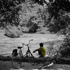 Summer Dreams (rossparsons2) Tags: people nature water bike yellow asia cambodia outdoor vehicle selectivecolour