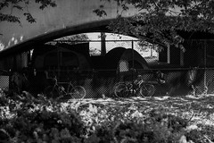 Town within a Town (votsek) Tags: 2016 lawrence homeless fence tent bicycle bridge viaduct park monochrome blackandwhite