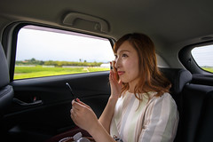 Young woman making up in car (Apricot Cafe) Tags: asianethnicity canonef1635mmf28liiusm japan kanagawa car enjoy happiness indoor oneperson summer transporting traveldestinations vacation weekendactivities woman youngadult zamashi kanagawaken jp img647320