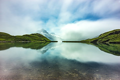 Bachalpsee in the Clouds / Re-edited (prothja1) Tags: ifttt 500px lake switzerland mountain mountains sky clouds water blue sun light reflection green summer long exposure see hills bachalpsee suisse grindelwald