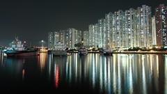 Tsuen Wan West (Wilson Au   ) Tags:    tsuenwanrivierapark hongkong water reflection buildings light night canon slowshutter longexposure eos5dmarkiii ef2485mmf3545usm landscape