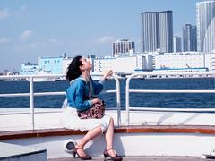 Feel the wind (Ted Tsang) Tags: travel sea portrait sky people girl japan skyline river hair tokyo boat ship wind candid olympus tourists tsukiji   odaiba sumidagawa sumida  minato  em1    suijobus 1240mmf28