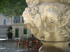 fountain mouth (Ladybadtiming) Tags: carpentras city urban stone fountain mouth face carved sculpture refreshing water flow tree quiet