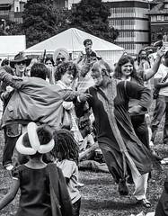 Round and round (David Feuerhelm) Tags: nikkor monochrome bw people crowd dance cambridge nikon d7100
