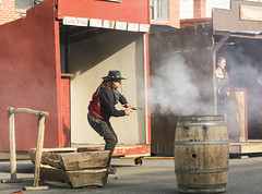 Gunsmoke (wyojones) Tags: cody wyoming codygunfighters irmahotel show performance outlaw performer gunfighter man pistol revolver shoot gunfight gunsmoke stance hat cowboyhat barrel hitchingrack watertrough