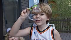 2 bubbles: 2 obscured faces (Pejasar) Tags: grandkids children bubble play porch estespark colorado cousins bubblewand green kids fun happy