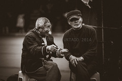 engrossing conversation... (chiyowolf) Tags: chengdu sichuanprovince china streetscenes blackandwhite facesofchengdu peopleofchengdu candidphotography oldmen seniorcitizens ef70200mmf28lisiiusm canoneos7d  travelphotography