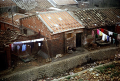 32-850 (ndpa / s. lundeen, archivist) Tags: nick dewolf nickdewolf 32 reel32 color photographbynickdewolf 1970s 1972 fall film 35mm winter republicofchina taiwan taiwanese china chinese buildings houses homes roofs rooftops clothes clothesline clotheslines brick rocks 1973