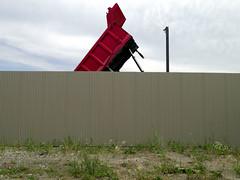 Red Dump Truck (geowelch) Tags: etobicoke toronto urbanlandscape urbanfragments dumptuck wall panasoniclumixgx1 panasoniclumixgvario1232mm3556