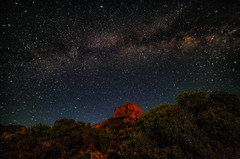Milky Way hovering over Casa Grande Peak in Chisos Mountains at Big Bend National Park