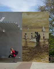 1915: Mouth of the Maitai river (Steve Taylor (Photography)) Tags: 1915 mouthofthemaitairiver sailing boat rucksack mobile phone art artwork graffiti mural picture streetart wall brown bench seat water river boy child children lad man men woman newzealand nz southisland cloud nelson tourist