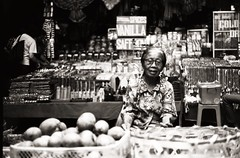 Market Lady, Ubud (AlexDenvorB) Tags: black white market shop asia