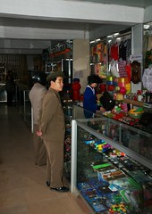 Local shop Rajin (Rason) (Frhtau) Tags: dprk north korea korean people leute street scene centre town daily life asia asian east nordkorea passers by shop local rajin rason economy new reform sell zone speicla trade status man woman customer kunden wirtschaft handel gebude architektur design scenery   choxin  outdoor      corea del norte core du nord coreia do coria    culture stadt gebudekomplex public