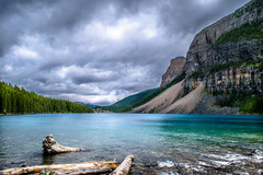 The Other Side of Lake Moraine (rezateddy) Tags: lake lakemoraine water colorful canada alberta moraine trees mountains clouds overcast gloomy
