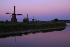 Five windmills (alideniese) Tags: sunset sky colour reflection river reeds landscape outdoors evening purple dusk nederland thenetherlands windmills waterlilies kinderdijk molen waterscape southholland