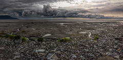 Stormy sunset (Traylor Photography) Tags: grass dad storm cloudy mudflats mountains darkness panorama shore tide grey turnagainarm dark barren front beach water light cookinlet sunset