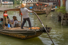 boatman (stevefge (away for a few days)) Tags: china shanghai watertown people candid boats water street reflectyourworld zhujiaujiau