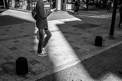 walking in light (Laixiang Pow) Tags: walking light street urban snap monochrome mono black white man male cool best great tokyo japan asia asian earth canon leica fashion feel nice city culture daily life love nyc new york hunter film