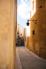 Crazy alleys (lorenzoviolone) Tags: buildings finepix fujiastia100f fujix100s fujifilm fujifilmx100s lamps vsco vscofilm x100s alleyway bricks clouds empty houses mdina mirrorless neighborhood nopeople outdoors sky streetphoto streetphotocolor streetphotography trip:malta=feb2016 windows malta
