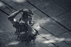 Down Up David (Revisited) (JeffStewartPhotos) Tags: blackandwhite bw toronto ontario canada david reflection pose puddle blackwhite photographer posing photowalk shooter mississauga toned hydrowires gridwork withcamera davidw torontophotowalk topw torontophotowalks longbranchportcredit longbranchandportcredit topwlbpc