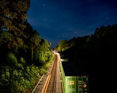 Headlights from NS 203 as it passes 214 at Arrowhead (bdunn829) Tags: longexposure nightphotography railroad night ns trains nightsky arrowhead 203 norfolksouthern 214 railfanning ns214 ns203 arrowheadvalleyroad