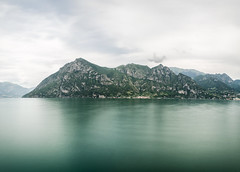 Big Friendly Giant // Marone (//Sebastian) Tags: lake lagodiseo iseosee iseo marone vello italia brescia green longexposure rock mountain sky clouds desaturated water smooth panorama autostitch parzanica rivadisolto detail nature view minimal huge giant cloudy warm wide