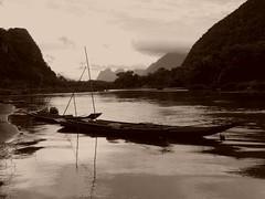 Le temps s'coule.. Time flows... (alainpere407) Tags: sepia boats bateaux laos muangngoi triptolaos alainpere