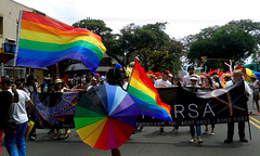 Multicolor: This picture corresponds to the Gay Pride or Marcha de la Diversidad, an event that took place for 7th consecutive year in San Jos, Costa Rica. From a humble start, with just 100 participants, the event has grown to over 40.000 participants, (vantcj1) Tags: multitud rtulo igualdad diversidad orgullo lgbti gente calle urbano manifestacin bandera paraguas vegetacin