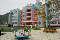 New orphanage near Wonsan (Frhtau) Tags: dprk north korea korean people leute street scene centre town daily life asia asian east nordkorea passers by architecture wonsan building gebude architektur design scenery   choxin  outdoor      corea del norte core du nord coreia do coria    culture landstrase stadt gebudekomplex public