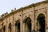 Nimes (25)-v2 (eelcowest) Tags: france nimes amphitheatre arenaofnîmes arena roman boulevard arènes outdoor skyline building architecture monument rampart arch tourists people holiday vacation summer city centre ancient antiquity stone