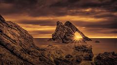 Awoken . (Derek Coull) Tags: sunrise bowfiddlerock portknockie duotone tonedblackwhite moraycoast naturalarch scotland