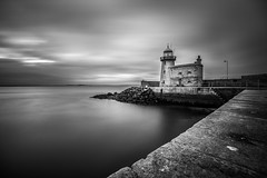 Lighthouse in Howth, Dublin (Wojtek Piatek) Tags: ireland blackandwhite howth dublin irish seascape architecture zeiss landscape mono harbor pier long exposure harbour sony lighhouse a99