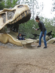 Playing in a fossil (jamica1) Tags: park canada calgary mom skull zoo child dinosaur alberta prehistoric