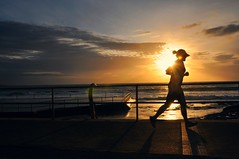 Running in sunshine (Explore) (missgeok) Tags: sunrise lady silhouette cronullabeach sydney australia running exercising morning beach sun sunflare focus sea horizon atmosphere mood fitness clouds sky nikon perfecttiming inthesun runninginthesun runninginsunshine dawn timelycapture rightmoment