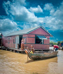Boy from a Cambodian Fishing Village (sachasplasher) Tags: poor poverty cambodia asia boat lake fishing village villager sky floating house