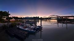 () (szintzhen) Tags: bridge sky reflection water sunrise boat taiwan photomerge        sunglow       newtaipeicity