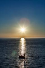 Sunset in Port de Sollr (tribalandre) Tags: sunset port de sollr mallorca nautilus restaurant sun water boat