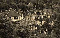a little Balinese history (SM Tham) Tags: asia indonesia bali island karangasem amlapura tamanujong waterpalace gardens gardenstosee buildings gazebo pavilion bridge pond water reflections trees sepia monochrome outdoors