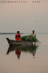 LIFE ON A BOAT... (Subhrajyoti89) Tags: life work river boat assam tezpur