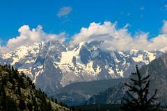 Mont Blanc (AlessandroGoi) Tags: sky italy sun mountain green grass clouds canon landscape photography italia raw bluesky adobe editing fotografia sole montagna montblanc montebianco valledaosta vda