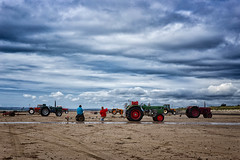 Waiting for the Oyster Catchers (Hugh Rawson) Tags: clouds france sky stgermainsuray tractor beach normandy cloud