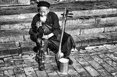 let me have one more cigarette (csalirod) Tags: life old man solitude cigarette beijing silence wisdom bnw
