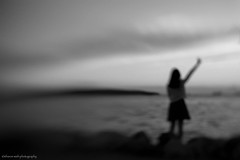 she tried to catch the wind (bluechameleon) Tags: sharonwish bw blackandwhite bluechameleon blur clouds lensbaby melancholy moody ocean rocks summer sunset woman monochrome sixwordstory water outdoor lensbabycontrolfreak