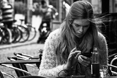 Volatile Messages (Alfred Grupstra Photography) Tags: bw blackandwhite people phone street streetphotography streetlife sunlight wind woman leuven vlaanderen belgi be