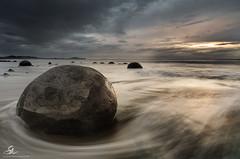 Moeraki sunrise (Seany99) Tags: newzealand moerakiboulders beach sunrise storm seascape shorescape
