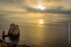 Sunrise (cee live) Tags: sea rocks cliffs sunrise sun morning canon flickr clouds calm boat daylight