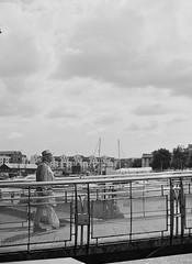 Summer Bridge (joshuacolephoto) Tags: street streetphotography bnw bw blackandwhite noir film 135 contrast 35mm nikon fe2 ilford xp2 400 bristol uk alone people individual candid space lines negativespace room city citycentre walk follow work love